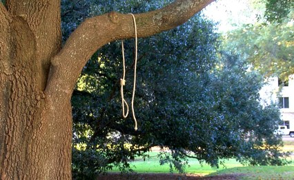 In this photo provided by WLBT-TV a noose hangs on a tree on the state capitol grounds in Jackson, Miss. on Monday, Nov. 26, 2018. A Mississippi official says two nooses and six signs were found on the grounds of the Mississippi state Capitol. Chuck McIntosh, a spokesman for the Mississippi Department of Finance and Administration, which oversees the Capitol, says the nooses and signs were found Monday morning between 7:30 a.m. and 8 a.m.