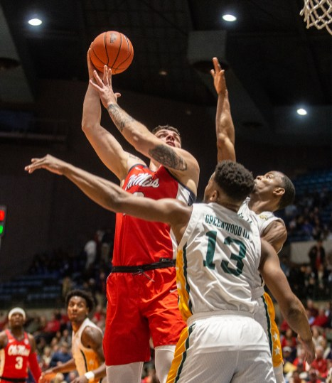 Ole Miss' Dominik Olejniczak (13) goes up for a shot against Southeastern Louisiana's defense during their game at the Mississippi Coliseum Wednesday, December 12, 2018. The game marked the Rebels' first game in Jackson in 11 years.