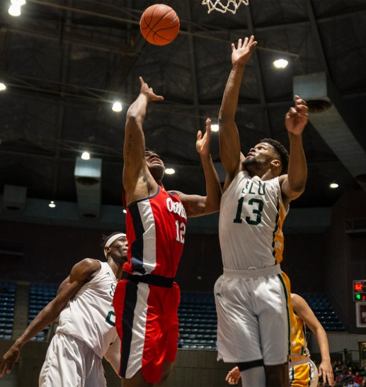 Ole Miss' Bruce Stevens goes up for a shot while being guarded by Southeastern Louisiana's Moses Greenwood during their game at the Mississippi Coliseum Wednesday, December 12, 2018.