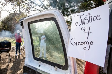 Signs hang after a protest against police violence and the death of George Robinson in Jackson Monday, January 21, 2019.