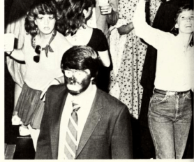 The 1984 Mississippi State University yearbook shows a member of the Phi Tau fraternity with a darkened face. No caption or further explanation was published.