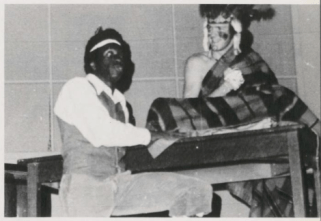 "An uncaptioned photo from the ""Student Life"" section of the Mississippi College 1977 yearbook shows one student wearing blackface and another wearing a costume reminiscent of Native American dress"