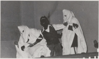 "An uncaptioned photograph from the ""Student Life"" section of the 1977 Mississippi College yearbook shows a student in blackface being grabbed by two students dressed as members of the Ku Klux Klan"
