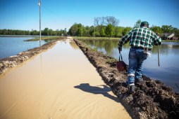 Anderson Jones Sr., who was injured in the 1990's, carefully walks around the flooding near his home Monday, April 15, 2019. The journey to his home is a little less than a mile.