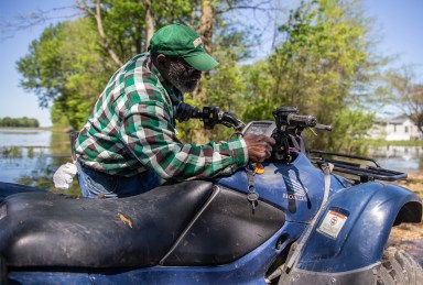 After using a boat to get to his home, Anderson Jones Sr. uses an ATV for the remainder of his journey through flood water to get to his home in Fitler, Miss., Monday, April 15, 2019.