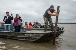 Lacey Little shows how deep the flood waters are during a media tour of the natural disaster near Mayersville Miss., Friday, April 5, 2019.