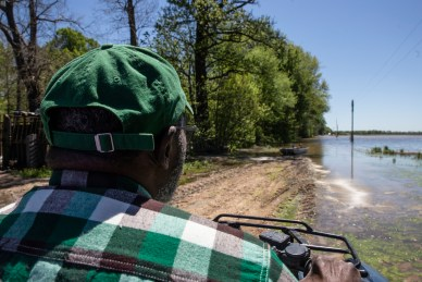 Anderson Jones Sr. rides an ATV and has to use a small boat during his journey to and from his home.