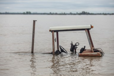 Farm equipment is nearly submerged in flood water in north Issaquena County, Miss., Friday, April 5, 2019.