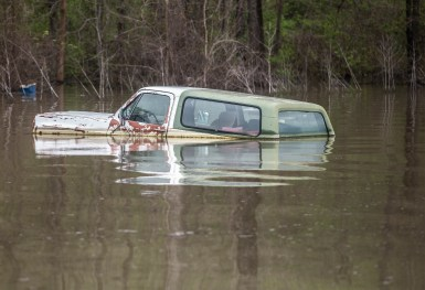 A truck is nearly submerged in flood water in Issaquena County Friday, April 5, 2019.