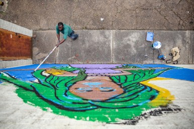 Jackson native Justin Ransburg works on his mural near the intersection of West Monument and Capitol Streets in downtown Jackson, Wednesday, March 17, 2019.
