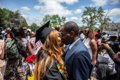 Graduate Kristyn Newman, left, kisses her boyfriend, Carnell Taylor, during Tougaloo College's Sesquicentennial Commencement Exercises at Tougaloo's campus Sunday, May 5, 2019. Carnell, who serves in the army, surprised Kristyn after returning from Germany.