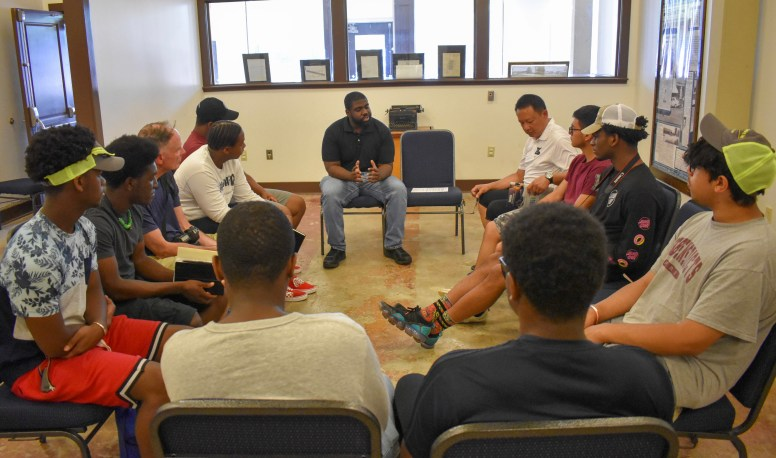 Ben Saulsberry, staff member at the Emmett Till Interpretive Center, gives the St. Benedict's Preparatory School group more information about the center and the climate of Sumner post-Emmett Till trial.