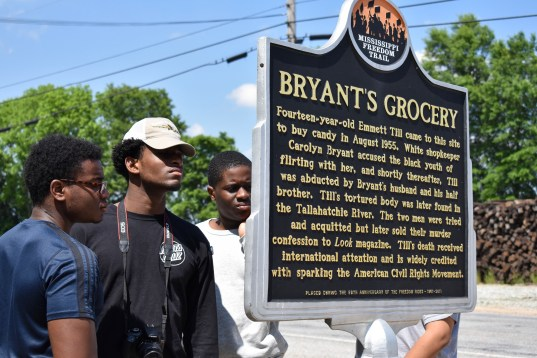 Students from St. Benedict's Preparatory School read the marker located in Money, Miss.