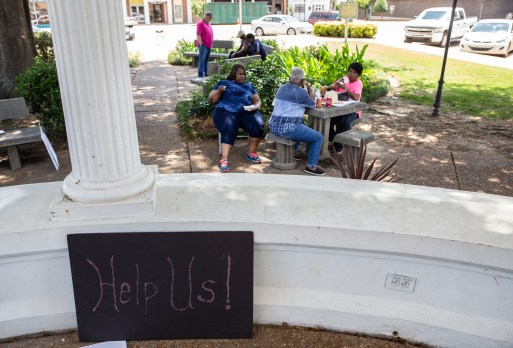 Eastern Heights Subdivision residents wait to hear from Grenada Mayor Billy F. Collins during a rally in Grenada, Miss., Wednesday, May 29, 2019.