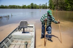 Anderson Jones Sr., 59, gets out of his boat and prepares to walk back to his car to get to the medicine he left behind in Fitler, Miss., Monday, April 15, 2019.