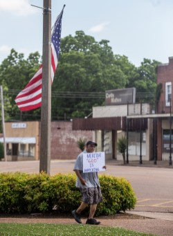 An Eastern Heights Subdivision resident protests in Grenada, Miss., Wednesday, May 29, 2019.