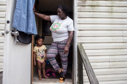 Jacqueline Fisher stands her granddaughter Rihanna Barret, 2, as she remembers her experiences with the flooding in Tchula caused by Tchula Lake.