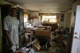 Willie Tucker surveys the damage of a home that was severely damaged by the flooding in Tchula, Miss., in Tchula, Miss., Thursday, May 9, 2019.