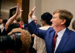 Lt. Gov. Tate Reeves gives a supporter a high-five after winning the GOP nomination for governor Tuesday, August 27, 2019.