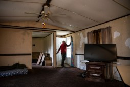 U.S. Army veteran Anthony Burkett looks out the front door of his damaged trailer in Seminary, Miss., Wednesday, October 30, 2019.