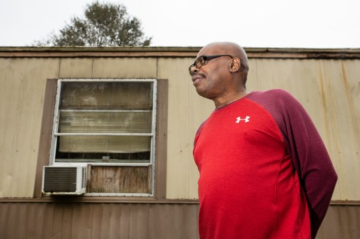 U.S. Army veteran Anthony Burkett stands in front his trailer in Seminary, Miss., Wednesday, October 30, 2019.