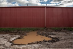 A large hole in the area where school buses pass is filled with rain water at S.V. Marshall Elementary School in Lexington, Miss., Thursday, October 31, 2019.