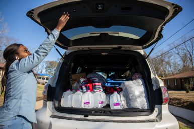 Coretta Frazier prepares to make more stops to the homes of those affected by Monday's tornado in Edwards, Miss., Thursday, December 19, 2019.