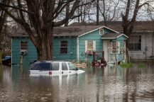 Homes on Nichols Street are surrounded by flood water in Jackson, Miss., Monday, Feb. 17, 2020.