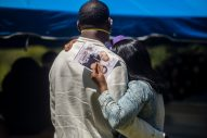 Lekava Rollins holds onto her partner John Patrick while attending a graveside service for their cousin Shalondra Rollins on April 16, 2020.