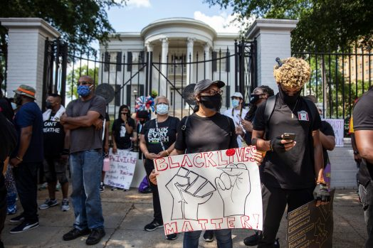 Protesters gather in front of the Governor's Mansion during the Black Lives Matter protest in downtown Jackson, Miss., Saturday, June 6, 2020.