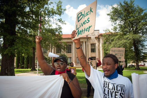 Protestors demand the Confederate statue come down outside the Bolivar County Courthouse in Cleveland, Mississippi on July 3, 2020.