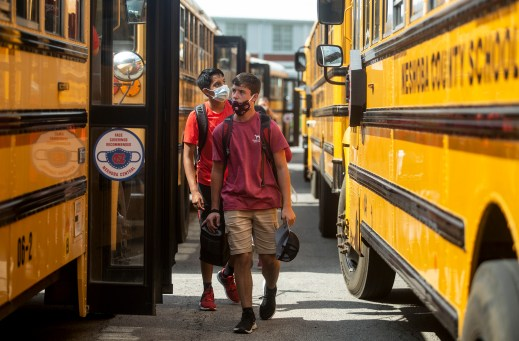 Neshoba County School District students get board school buses after the district's first day of school on Wednesday, August 5, 2020.
