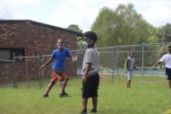 Dallas Hill, who attends the Boys and Girls Club Walker unit in south Jackson, plays touch football with his classmates after completing distance learning for the day on Sept. 14, 2020. The kids must wear masks and remain socially distanced while they play due to the COVID-19 pandemic.