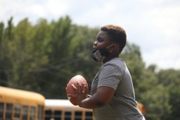 Charles plays quarterback with his classmates at the Boys and Girls Club Walker unit in south Jackson on Sept. 14, 2020. After the kids who attend the club complete their schoolwork online during the day, the Club offers some of its normal after school activities.
