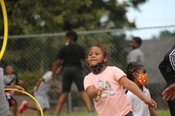 Rachel throws a hula hoop to a Boys and Girls Club instructor during recess at the Walker unit in south Jackson on Sept. 14, 2020.