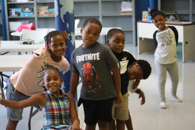 5 and 6-year-olds at the Boys and Girls Club Capitol Street unit in west Jackson giggle and roughhouse near the end of their school day on Sept. 21, 2020.