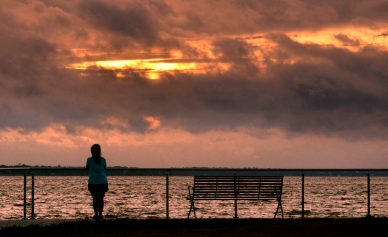A Mississippi Gulf Coast resident ventures out to Point Cadet in Biloxi Monday morning. Residents hoped to see one more sunrise before Tropical Storm/Hurricane Sally gets closer with feeder bands arriving today. Instead, ominous skies blocked the sunrise and reminded those what was in store for the area.