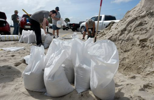 Joseph Radford fills sand bags near Ken Combs Pier in Gulfport Monday afternoon. Much of the Mississippi Gulf Coast is under a hurricane warning as Tropical Storm Sally gets closer to land fall.