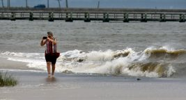 Mississippi Gulf Coast residents took to the beach as Hurricane Sally made a turn toward Mobile, Ala., Tuesday. Residents walked the beach and took pictures of the waves crashing ashore.