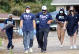 Democratic U.S. Senate challenger Mike Espy and campaign workers canvass the Valley North subdivision on Oct. 23 in Jackson.
