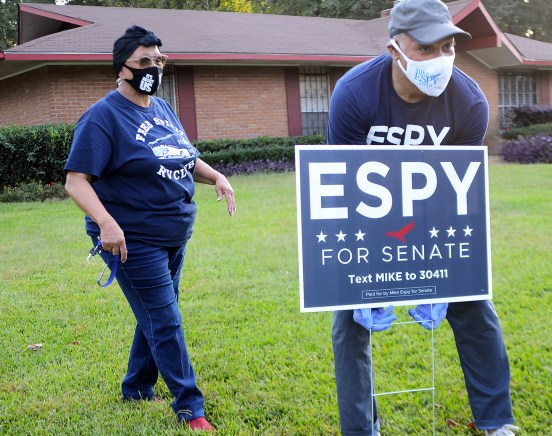 """Valley North Subdivision resident Caroline Dace offers advice to Democratic U.S. Senate challenger Mike Espy on exactly where she'd like him to place his campaign sign in her yard. """"I want everyone to be able to see it,"""" said Dace. Espy and campaign workers canvassed the north Jackson neighborhood on Oct. 23."""