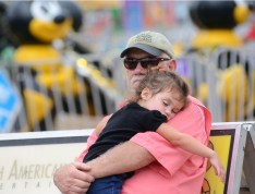 Bentley Welborne, 3, all tuckered out from a Thursday afternoon at the State Fair, with her Paw Paw Cliff Melborne of Florence.