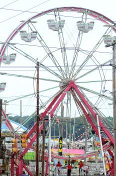 Ferris wheel workers await their next riders.