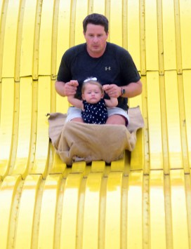 At the end, the giant slide ride produced a big smile on 20-month-old Avery Milner's face. It was the actual slide down with dad, Joey Milner of Flora, that seeded a bit of doubt.