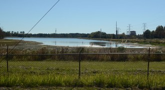 A southern view from Forest Avenue of water being drained from the Lake Hico area. The Rex Brown Steam Engine Station can be seen to the right.
