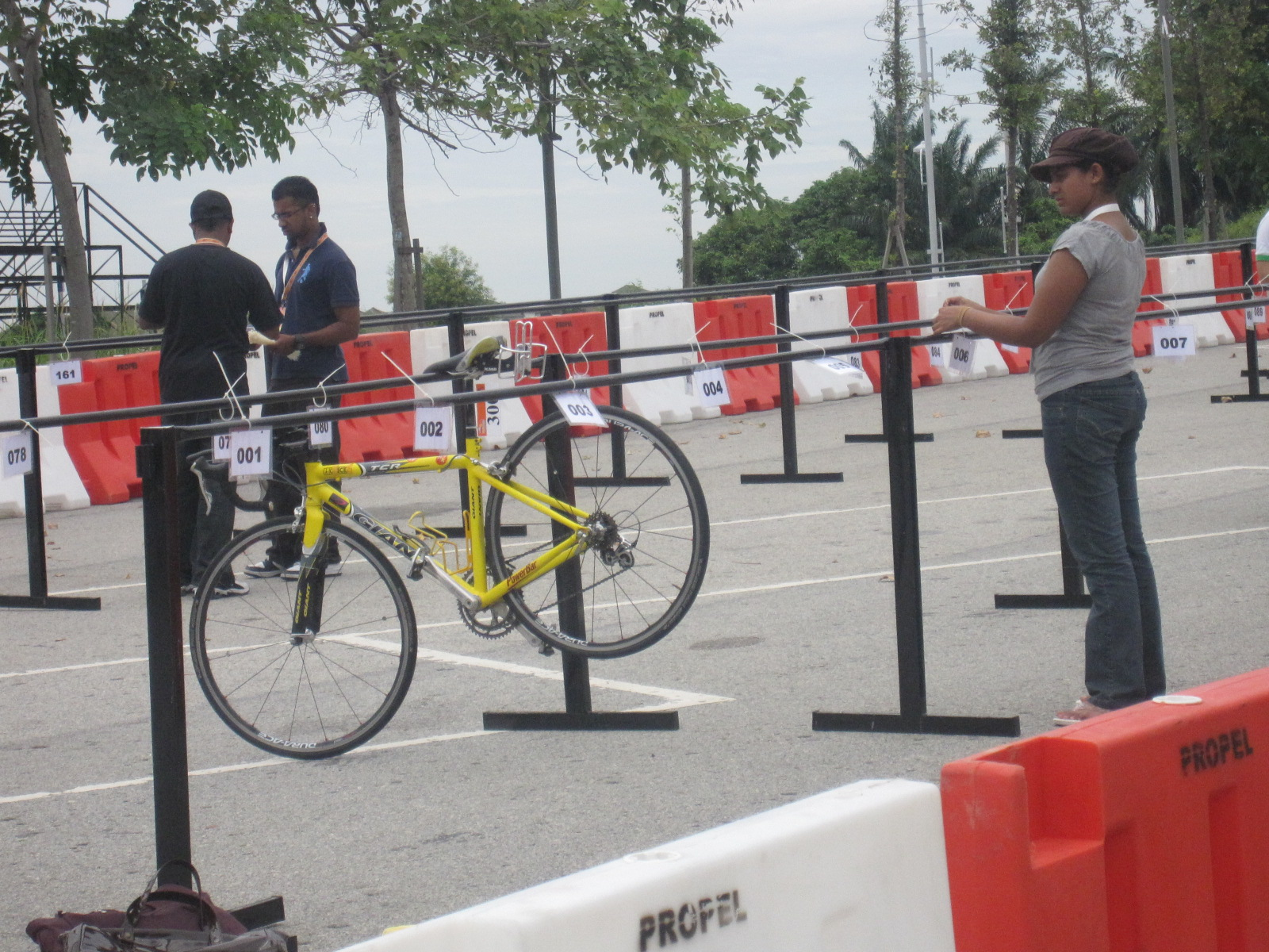 1st to check-in when the organizers are still busy tagging the racks. How's dat for a world standard race? Tomorrow my bike will be at its parking lot. Tadi gotta rush. Open house la !!!  Asked the ane, aunty and also Soffian to help check my bike is at #300. :P