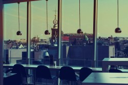 Some sort of rooftop cafe with glass walls that offered an amazing view