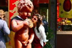 "Posing with a ""Manneken Pis"" themed statue outside a waffle restaurant in Brussels, Belgium (@kmtwanderlust photo/May 6, 2011)"