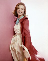 ca. March 1960, New York, New York, USA --- Model wearing pale linen dress and red French linen jacket, by Donald Brooks, turquoise Brania necklace, Scaasi earrings, and Revlon makeup. --- Image by © Condé Nast Archive/Corbis