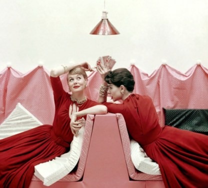 Two models wearing red dresses and playing cards, 1954